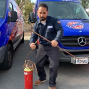 Plumber Ted Bustos Showing Off His Favorite Plumbing Tool